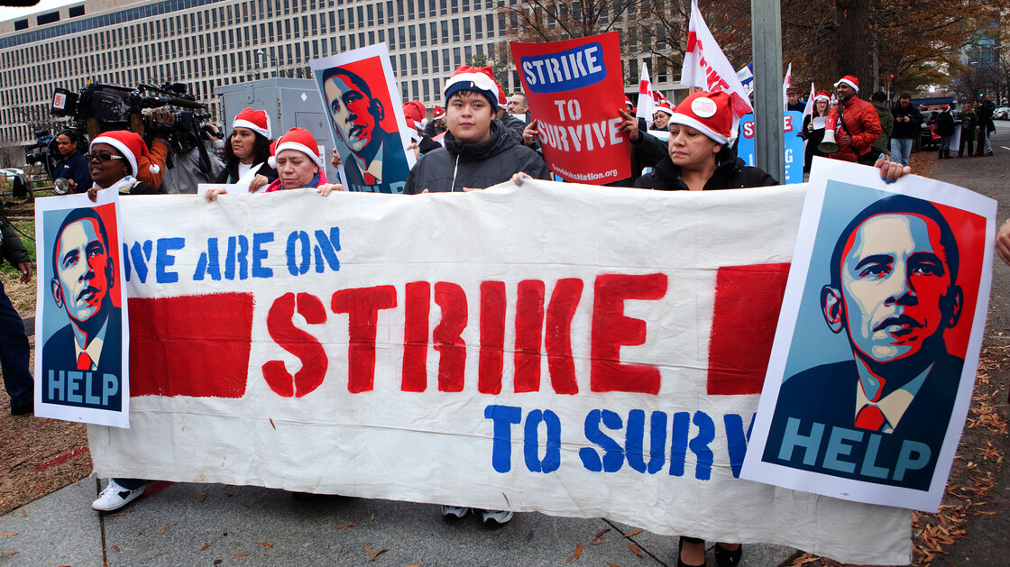 Fast-food workers march toward the Smithsonian's National Air and Space Museum in Washington, D.C., on Thursday. Similar rallies occurred in about 100 cities across the U.S.
