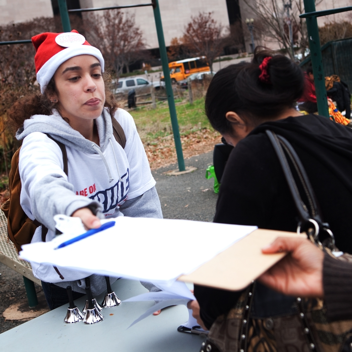 Amal Mimish, an organizer with Good Jobs Nation, registers protesters at the fast-food-workers' rally in Washington, D.C., on Thursday.