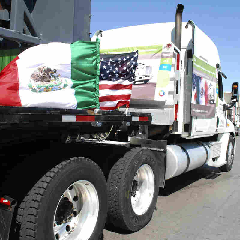 A truck bearing Mexican and U.S. flags approaches the border crossing into the U.S., in Laredo, Texas.