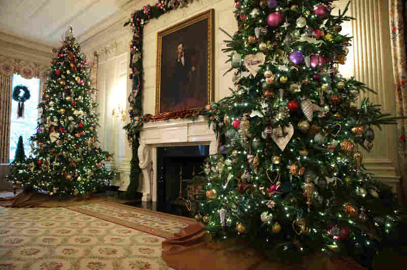 Holiday decorations are displayed in the State Dining Room of the White House during an event to preview the 2013 holiday decorations on Wednesday in Washington, D.C.