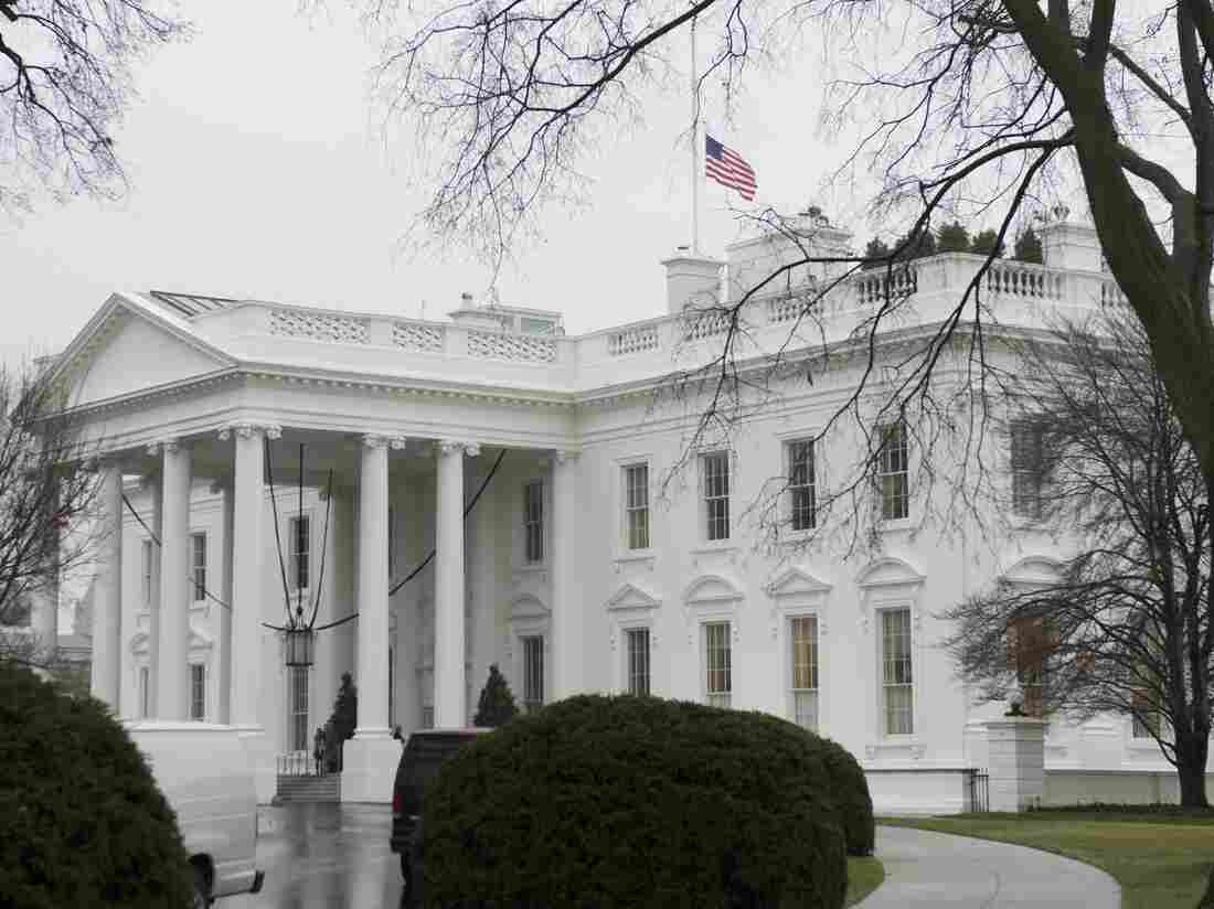 The U.S. flag flies at half-staff over the White House in Washington, D.C., in honor of former South African President Nelson Mandela.