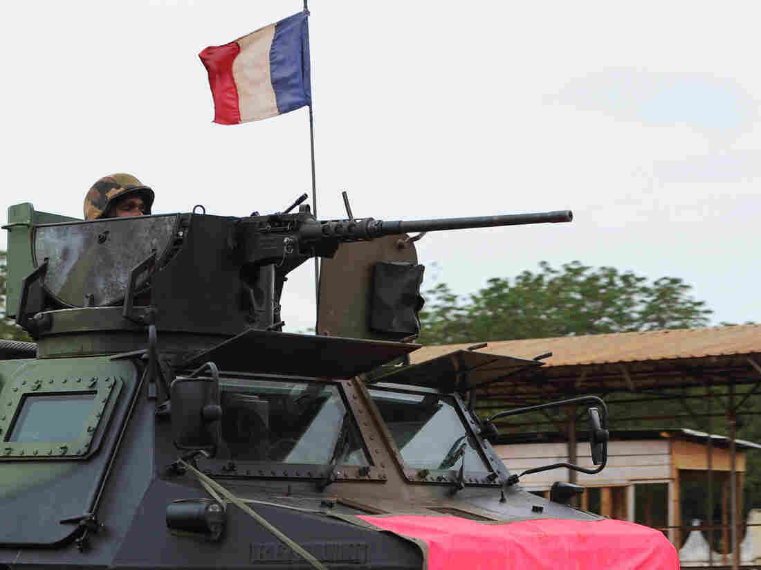 A French soldier looks out from an armored vehicle during a patrol through the streets of Bangui, on Thursday.