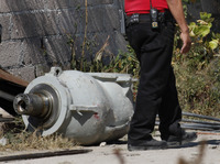 A firefighter stands next to the radiation head which contained the stolen cobalt-60.