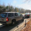 An unmarked New York State Police SUV pulls over a motorist for distracted driving. Troopers are using a fleet of the tall vehicles to crack down on texting while driving.
