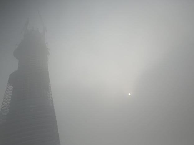 A building under construction is covered with haze in Shanghai on Friday. The city's pollution index is at its highest ever, officials say.