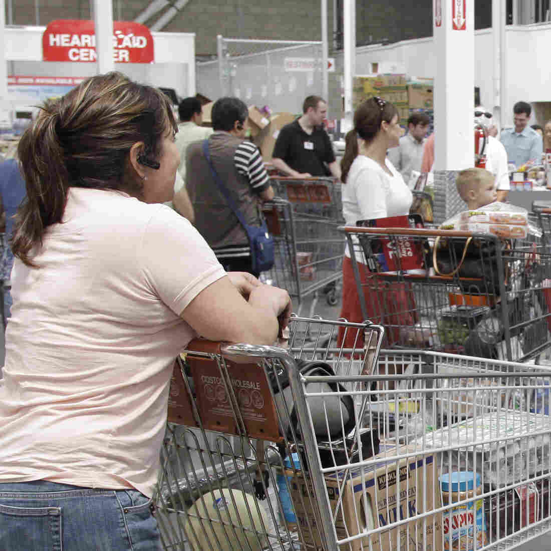 Shoppers get ready to pay at Costco Wholesale in Mountain View, Calif. For the next couple of weeks, Californians whose insurance was canceled have some unusual options, including an Aetna plan available only at Costco.