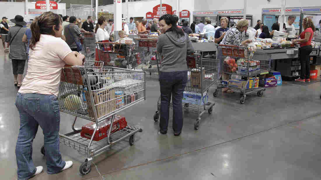 Shoppers get ready to pay at Costco Wholesale in Mountain View, Calif. For the next couple of weeks, Californians whose insurance was canceled have some unusual options, including an Aetna plan availab