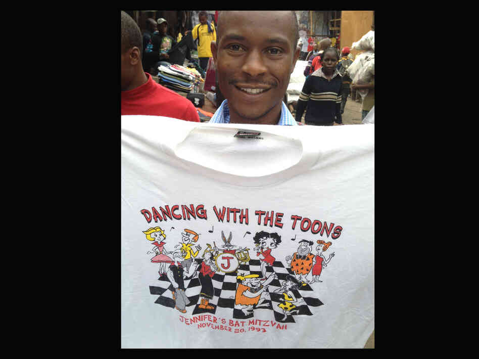 "A T-shirt for sale in an outdoor market in Nairobi, Kenya. The shirt reads ""Dancing With The Toons, Jennifer's Bat Mitzvah, November 20, 1993."""