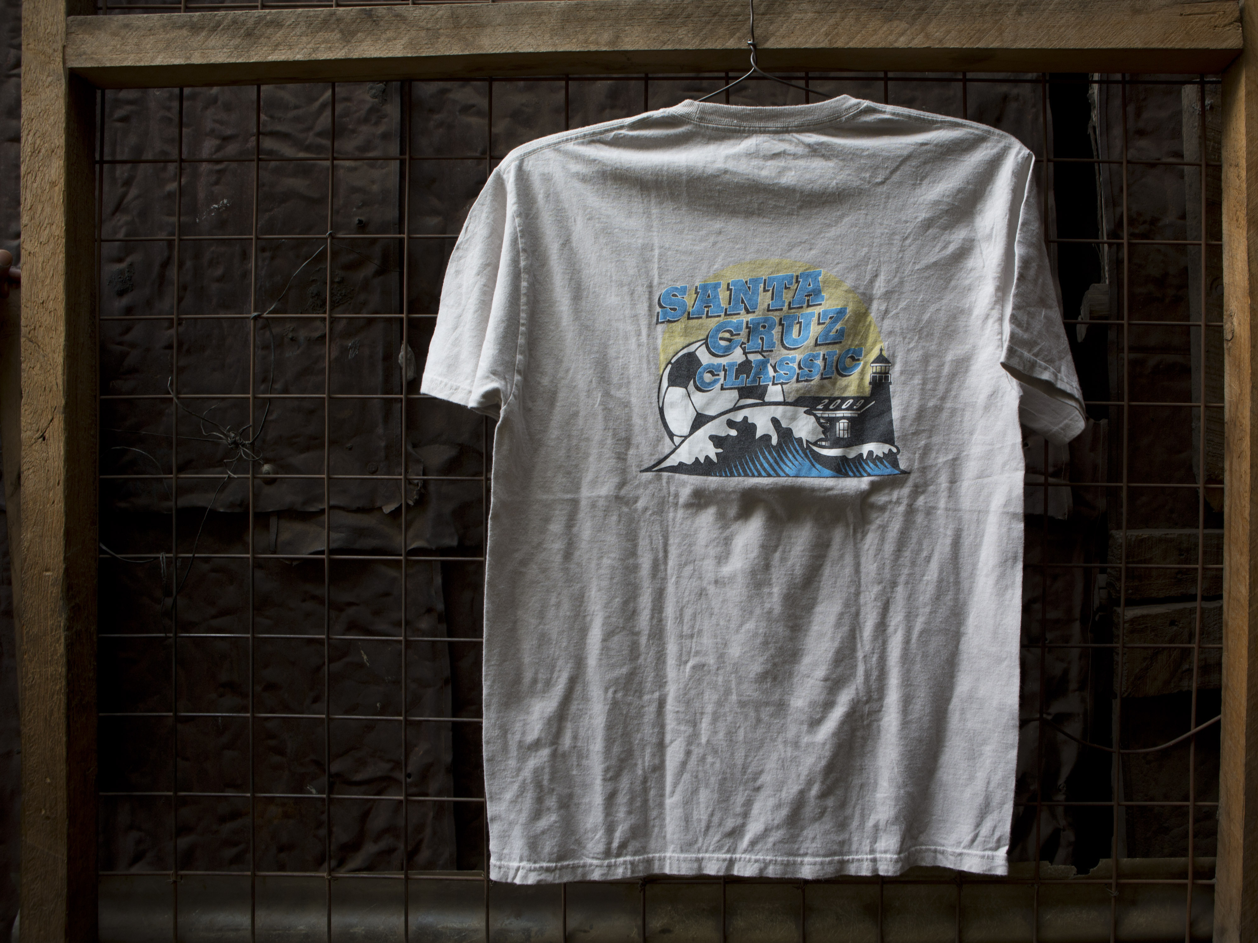 "A T-shirt for sale at Gikombo Market in Nairobi, Kenya. The shirt reads ""Santa Cruz Classic 2009."""