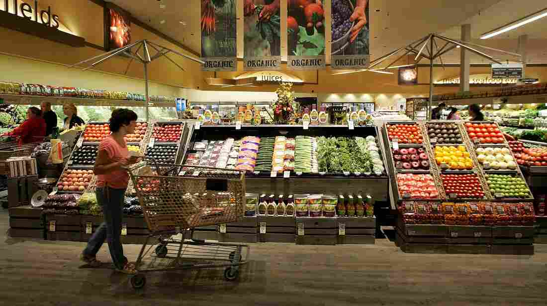 A Safeway customer browses in the fruit and vegetable section at Safeway in Livermore, Calif.