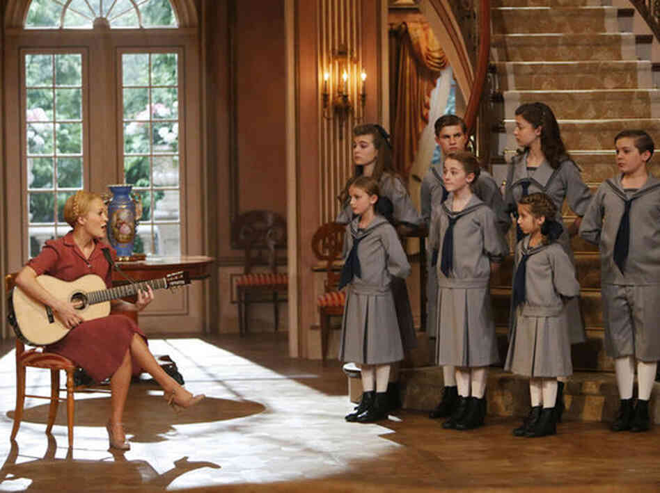 Carrie Underwood as Maria, with (back, from left) Ella Watts-Gorman as Louisa, Michael Nigro as Friedrich, Ariane Rinehart as Liesl, Joe West as Kurt and (front, from left) Grace Rundhaug as Marta, Sophia Ann Caruso as Brigitta and Peyton Ella as Gretl, in NBC's live production of The Sound Of Music.