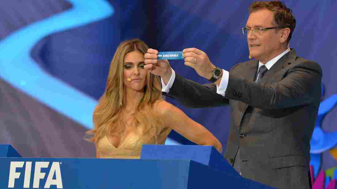 FIFA Secretary-General Jerome Valcke shows a paper with the name of the Korea Republic as Brazilian presenter Fernanda Lima looks on during the final draw of the Brazil 2014 FIFA World Cup Friday.