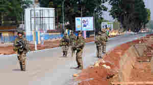 French troops patrolled the Central African Republic's tense capital on Saturday, as reinforcements crossed into the country as part of a UN-mandated effort to quell a wave of deadly sectarian violence.