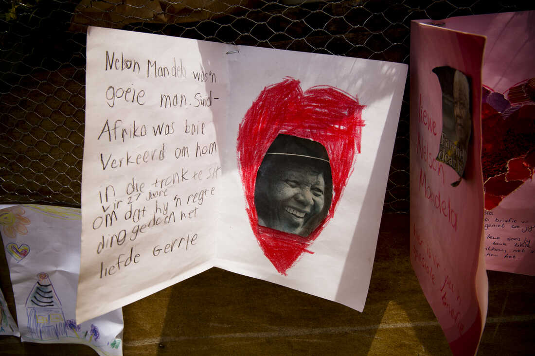 """A tribute left outside Drakenstein Prison (used to be called Victor Verster Prison when Mandela was there. He moved here after leaving Robeen Island). The translation reads: """"Nelson Mandela was a good man. South Africa was very wrong to put him in jail for 27 years just because he did the right thing. Love Gerrie."""""""