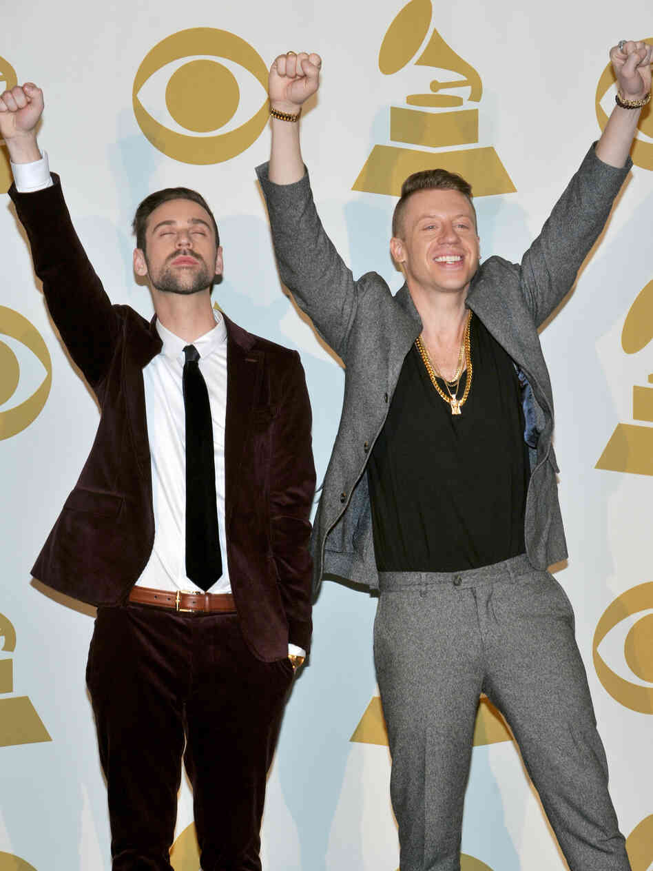 Ryan Lewis, left, and Macklemore pose backstage at the Grammy Nominations Concert Live! on Friday, Dec. 6, 2013, at the Nokia Theatre L.A. Live in Los Angel