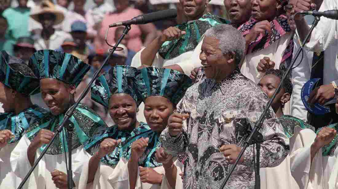 South African President Nelson Mandela joins the choral group at the signing of the country's new constitution at Sharpeville stadium in 1996.  Mandela lived a life filled with rich musical associations.