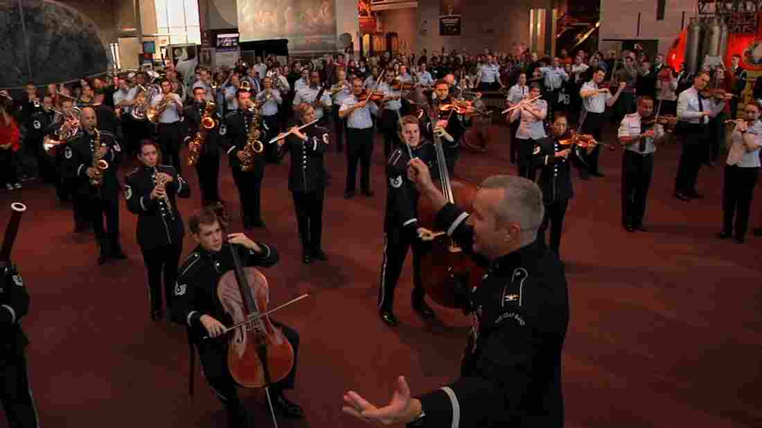 Col. Larry H. Lang conducts the Band's first-ever flash mob at the National Air and Space Museum on Dec. 3.