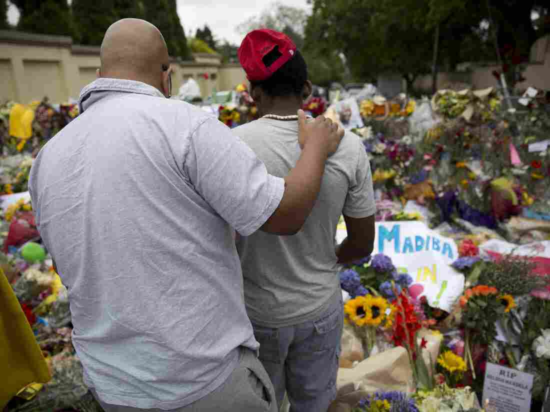 A sea of tributes grows outside the home of former President Nelson Mandela in Johannesburg, South Africa, on Sunday.
