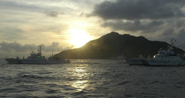 Japanese Coast Guard vessels sail near a group of disputed islands called Diaoyu by China and Senkaku by Japan.