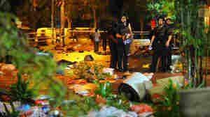 Riot police cordon off areas at Singapore's Race Course Road on Sunday to maintain order following a riot Sunday in the Little India neighborhood. Eighteen people were injured.