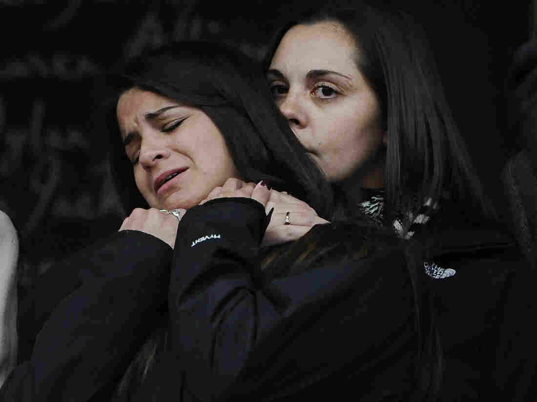 Erica Lafferty (right), daughter of Sandy Hook Elementary School shooting victim Dawn Hochsprung, consoles Carlee Soto, sister of victim Victoria Soto, after representatives of 14 families addressed the media on Monday in Newtown, Conn.