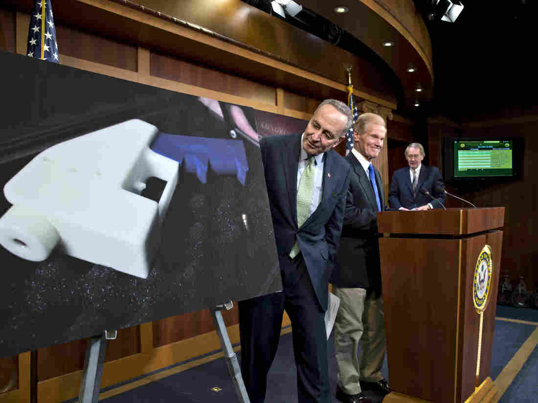 Democratic Sens. Chuck Schumer of New York and Bill Nelson of Florida talk to reporters about their effort to renew the ban on plastic firearms, at the Capitol on Monday.