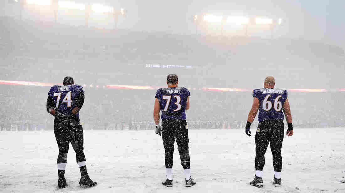 A winter storm is hitting an area from Virginia to New England, snarling traffic and closing schools. On Sunday, heavy snowfall changed the look of an NFL game in Baltimore, Md., where Ravens players stood for the national anthem at 1 p.m.