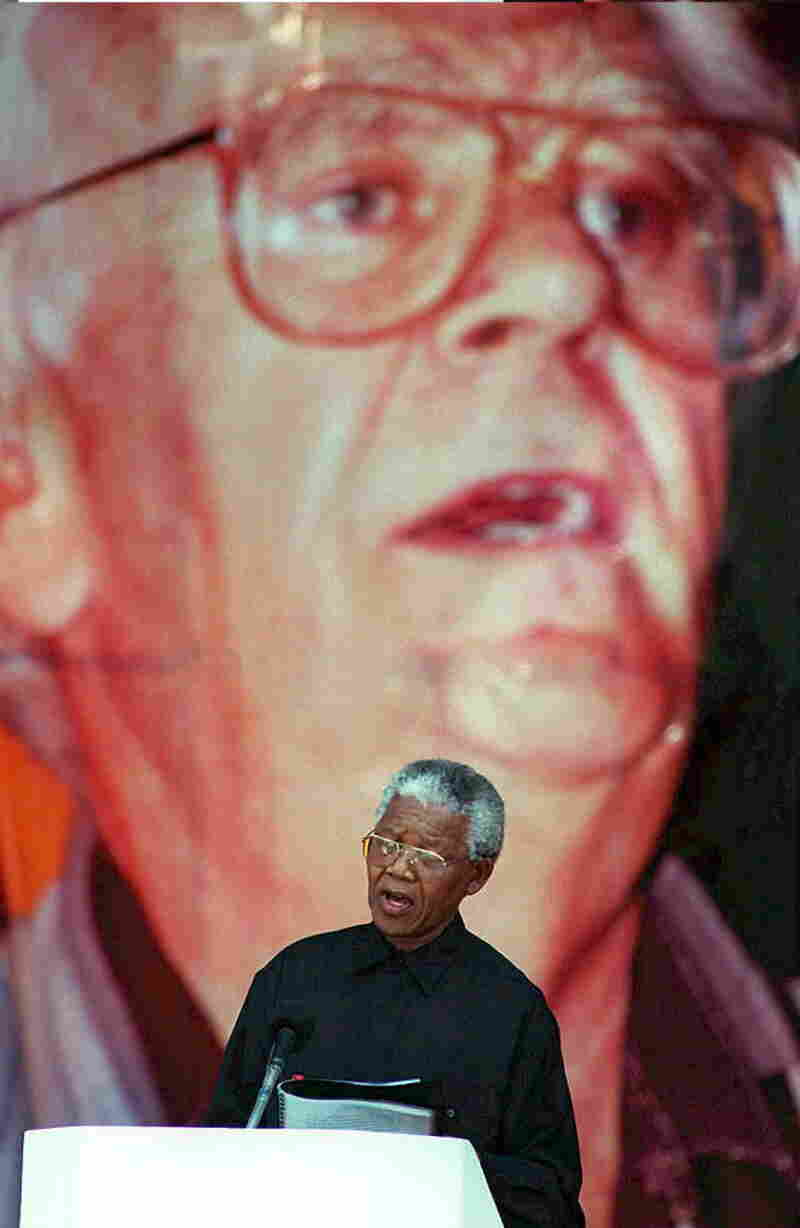 In 1995, then-South African President Nelson Mandela pays tribute at a funeral service for Joe Slovo, a leading white figure in South Africa's struggle for racial equality.