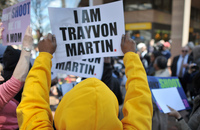 Protesters gather outside ALEC headquarters in Washington, D.C., on March 29, 2012, to protest stand-your-ground laws in the wake of the Trayvon Martin killing.