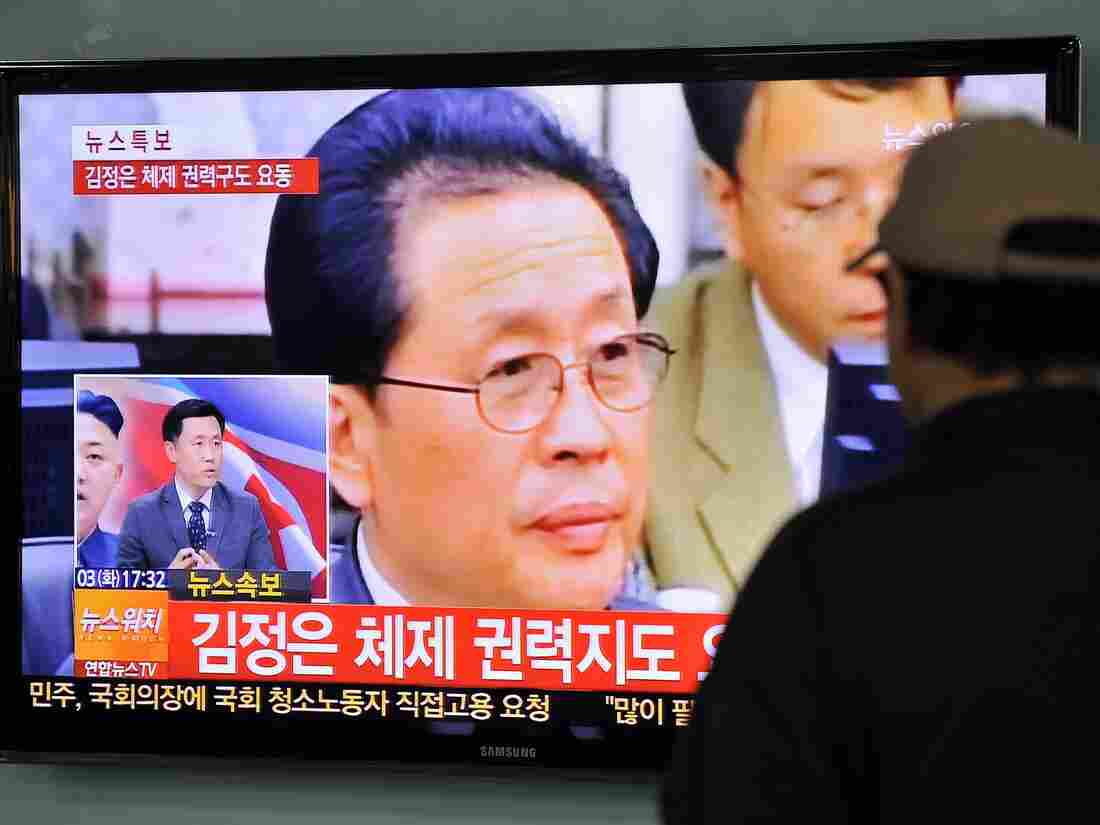 A South Korean man watches TV news about the dismissal of Jang Song-Thaek, North Korean leader Kim Jong Un's uncle, at a railway station in Seoul on December 3.