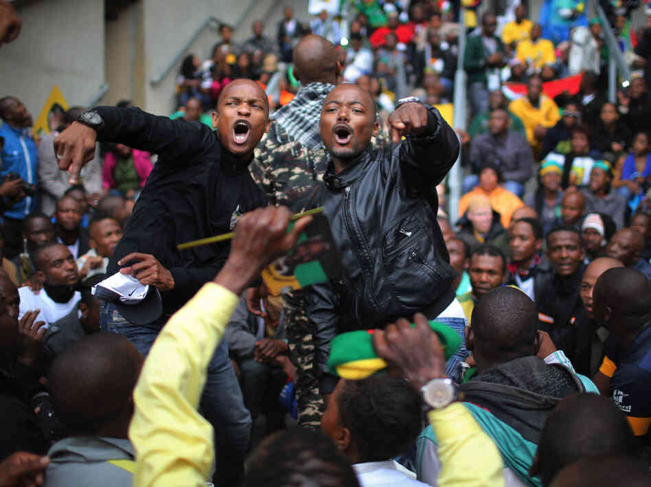 Members of the public sing and dance as they arrive for the Nelson Mandela memorial service at the FNB Stadium, on Tuesday in Johannesburg, South Africa.