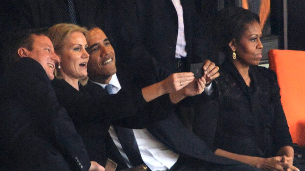 President Obama and British Prime Minister David Cameron pose for a picture with Denmark's Prime Minister, Helle Thorning Schmidt, during the memorial service for Nelson Mandela Tuesday in Johannesburg, South Africa. First lady Michelle Obama is on the right.
