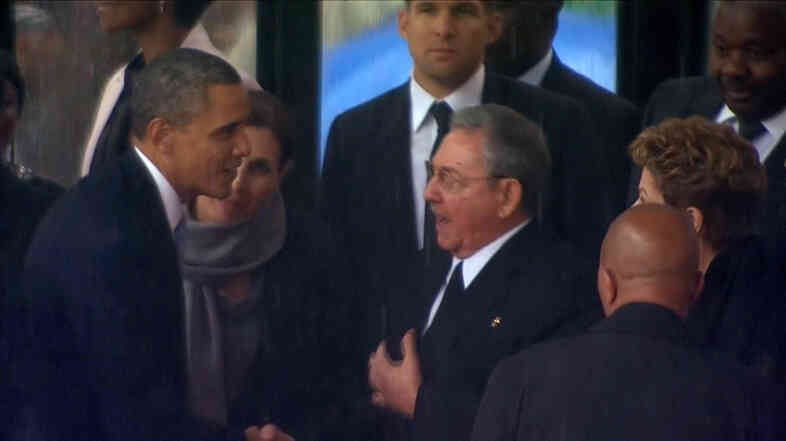 In this image from TV, President Obama shakes hands with Cuban President Raul Castro at the memorial service for former South African President Nelson Mandela in Johannesburg on Tuesday.