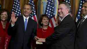 Texas Rep. Steve Stockman participates in a mock swearing-in ceremony with House Speaker John Boehner in January. Stockman made the surprise move to challenge Sen. John Cornyn in the 2014 Texas GOP primary.