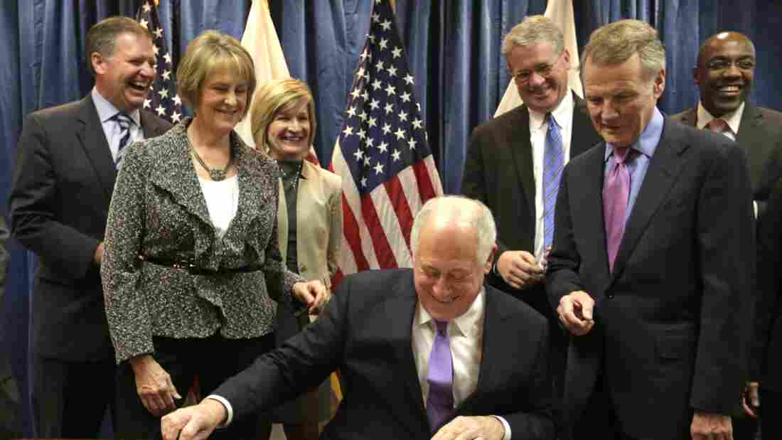 Illinois Gov. Pat Quinn smiles during the signing of the pension overhaul legislation bill on Dec. 5 in Chicago. Looking on from left are Sen. Bill Brady, R-Bloomington; Senate GOP leader Sen. Christine Radogno; Rep. Darlene Senger, R-Naperville; Rep. Jim Durkin, R-Western Springs; House Speaker Michael Madigan and Sen. Kwame Raoul, D-Chicago.