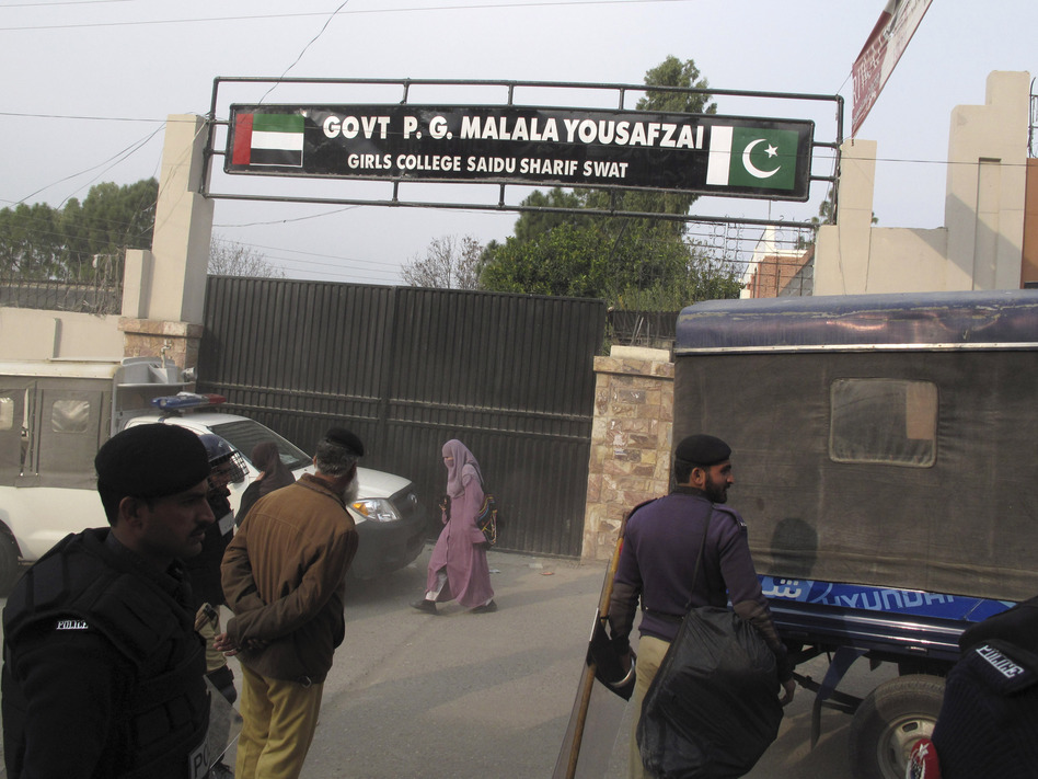 Police stand guard after students at Saidu Sharif College in Swat protested against a decision to rename the school after Malala Yousufzai, on Dec. 12, 2012. Angry students boycotted classes and tore up posters of teenage activist.