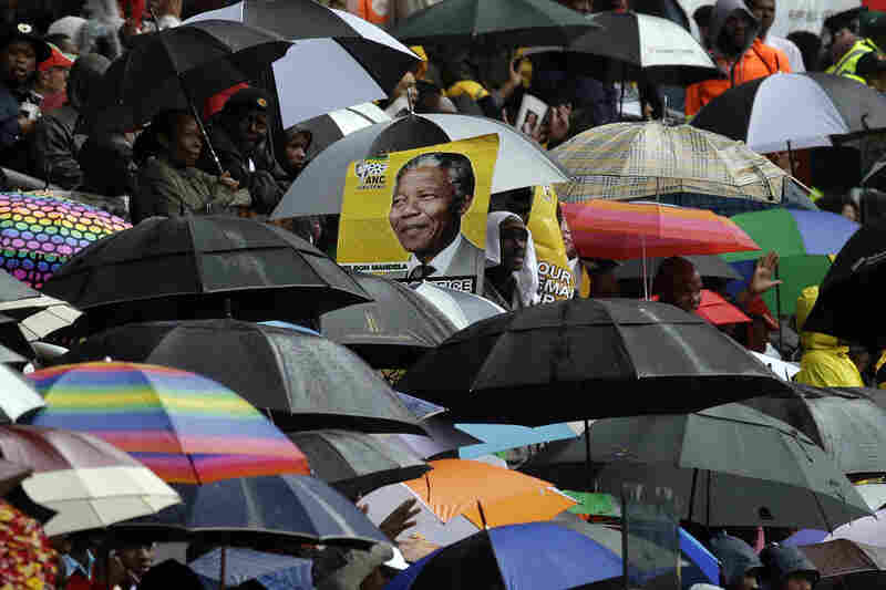 Tens of thousands of South Africans gathered at a stadium in Soweto on Tuesday to honor the life of former South African President Nelson Mandela. He died at his home Thursday, at the age of 95.