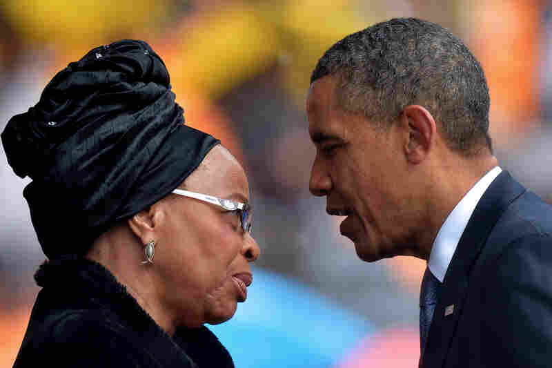 "President Obama talks with Mandela's widow, Graca Machel, during the memorial service. ""It was a memorial, but it was almost a thanksgiving as well,"" NPR's Ofeibea Quist-Arcton reports from South Africa. ""I think people are so grateful to what Nelson Mandela and his generation of freedom fighters did to liberate South Africa."""