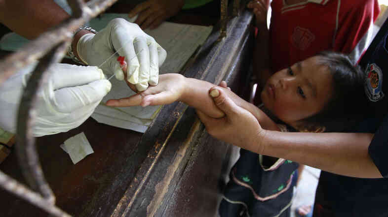 Children get tested for malaria at a clinic near the Myanmar border in Sai Yoke, Thailand. Drug-resistant strains of the parasite have appeared in the region over the past few years.