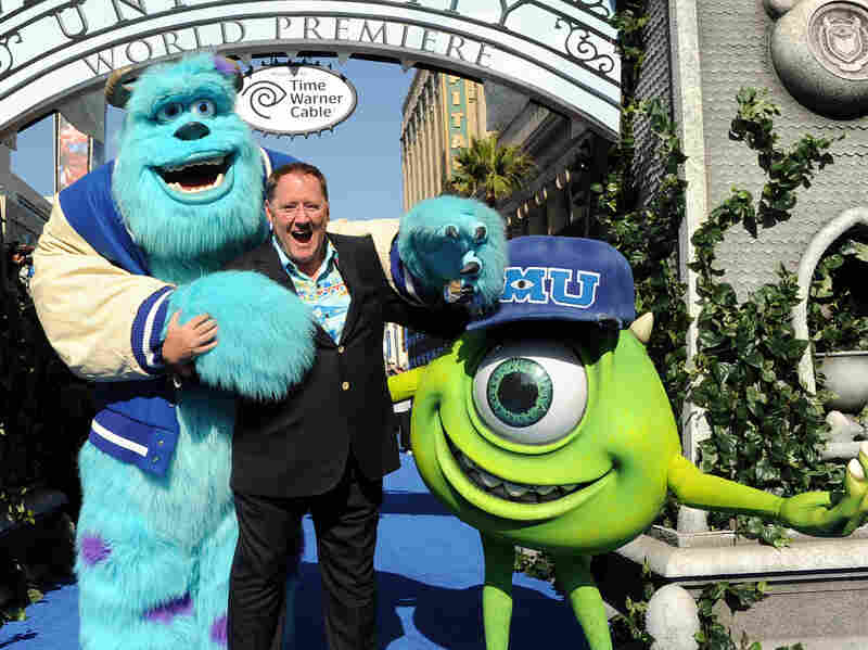 John Lasseter, flanked by Mike and Sulley, at the premier of Monsters University in June. Lasseter's career took him from Disney to Pixar back to Disney again.