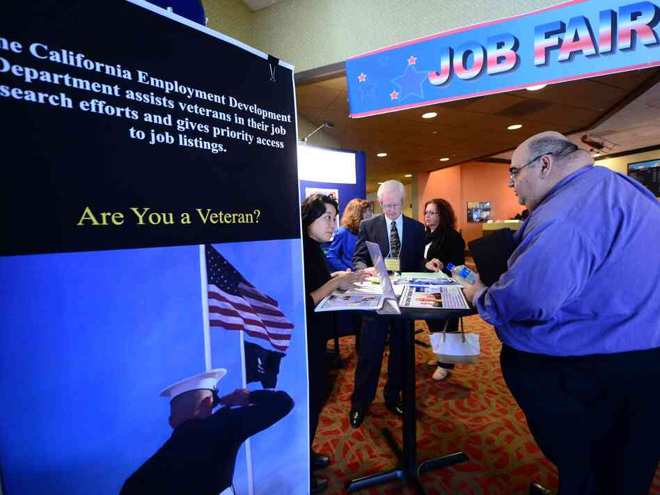 A prospective job seeker gets information at a job resource fair for military veterans in Van Nuys, Calif., on Oct. 24.