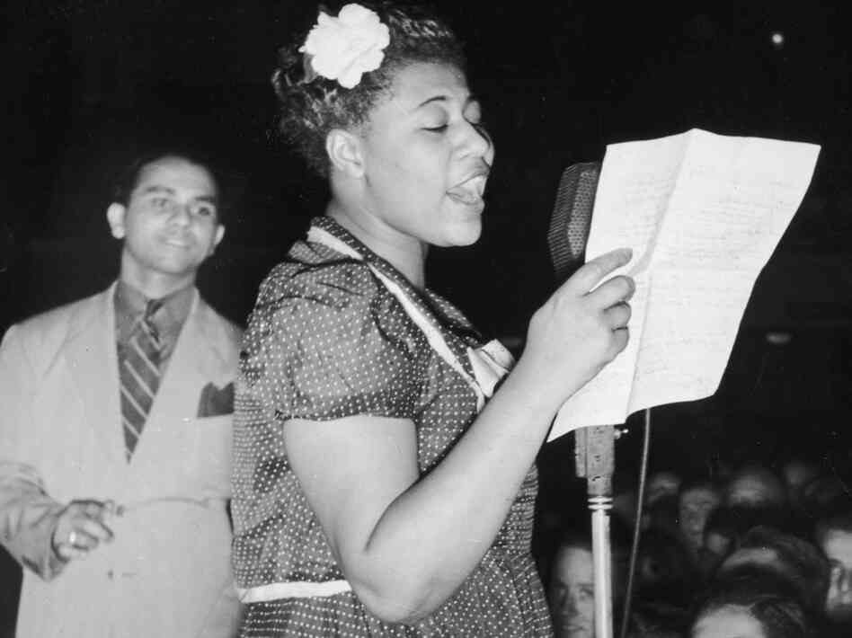 Ella Fitzgerald sings with bandleader Chick Webb in Asbury Park, N.J., in 1938.