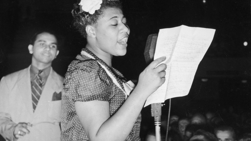 Ella Fitzgerald sings with bandleader Chick Webb in Asbury Park, N.J., in 1938. (Getty Images)