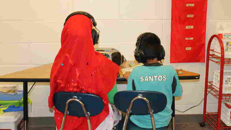 "Two students in a ""newcomer"" class at Florence Wilson Elementary School in Garden City — a Somali girl (left), and a Hispanic boy."