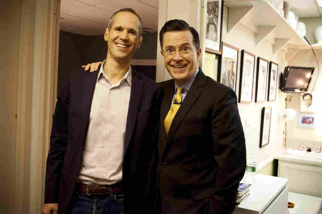 Planet Money's Alex Blumberg and Stephen Colbert after a taping of The Colbert Report on December 10, 2013.