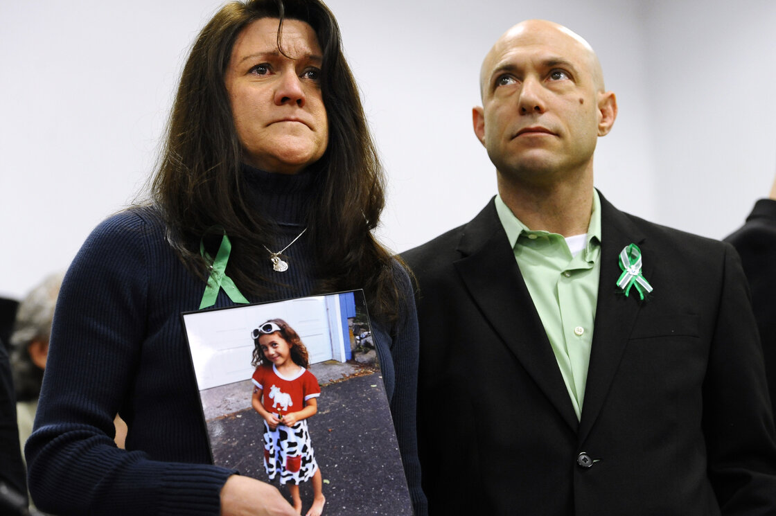 Jennifer Hensel and Jeremy Richman with a portrait of their daughter, Avielle Richman, at a news conference in Newtown, Conn., in January. The parents have created a foundation to fund research into the biochemical and environmental factors that drive violent behavior.