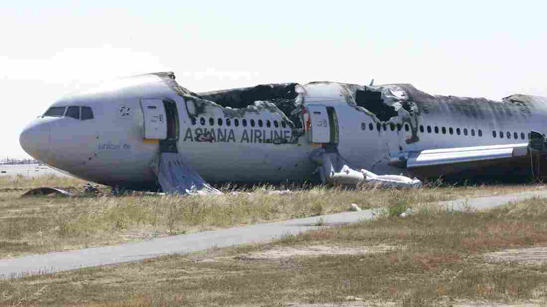 The wreckage of Asiana Airlines flight 214 on the runway at San Francisco International Airport last July.