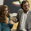Amy Adams and Christian Bale star as a couple of con artists in David O. Russell's American Hustle.