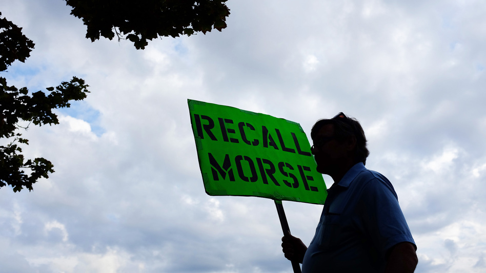 A man holds a sign advocating the recall of state Sen. John Morse in Colorado Springs, Colo., in September. Morse and a second state senator who backed the state's new gun control measures were recalled during a special election that month. (Matthew Staver /Landov)