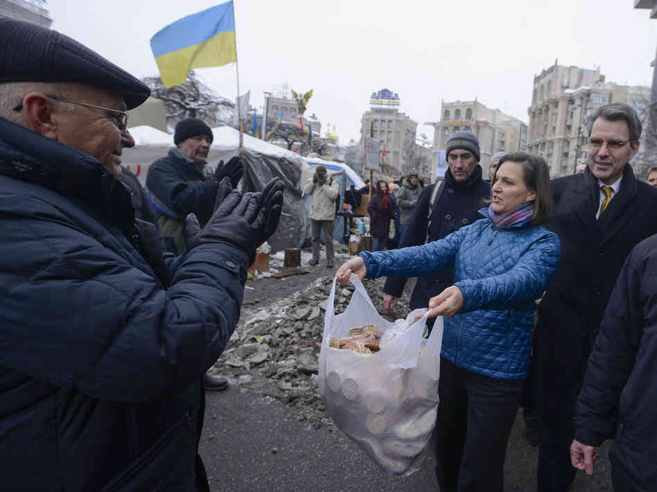 U.S. Assistant Secretary for European and Eurasian Affairs Victoria Nuland offered food to pro-European Union activists as she and U.S. Ambassador to Ukraine Geoffrey Pyatt, right, walked through Independence Square in Kiev, Ukraine, on Wednesday. She also offered food to some of the police near
